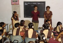 Students interacting with school girls at a village school