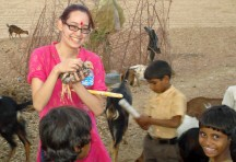 A student enjoying the company of village children and animals